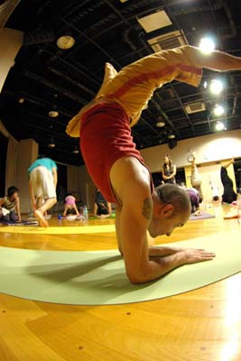 Teaching Pincha Mayurasana in Nagoya, Japan.